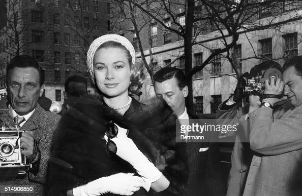 3/23/1956New York NY Actress Grace Kelly flashes a gracious smile for photographers as she arrives for the wedding of her fellow actress Rita Gam at...