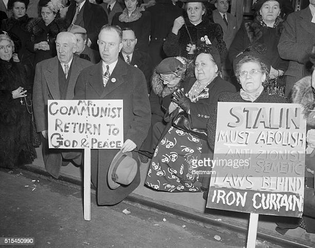 3/25/1949New York NY Anticommunist pickets some of them wearing traditional Croatian costumes kneel to pray outside the WaldorfAstoria Hotel as they...