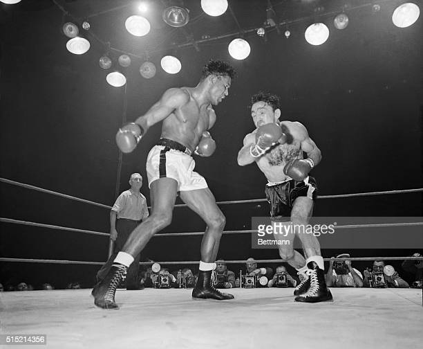3/25/1958Chicago IL Defending middleweight champion Carmen Basilio exchanges blows with Sugar Ray Robinson during the sixth round of their title bout...
