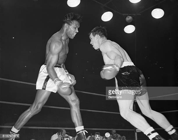 3/25/1958Chicago IL Sugar Ray Robinson throws a right to the head of Carmen Basilio during a late round of their middleweight title fight in the...