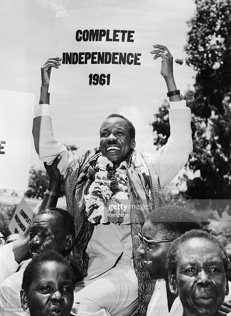 Garlanded with flowers, <a gi-track='captionPersonalityLinkClicked' href=/galleries/search?phrase=Julius+Nyerere&family=editorial&specificpeople=228294 ng-click='$event.stopPropagation()'>Julius Nyerere</a>, slated to become Tanganyika's first Prime Minister on May 1st, is carried by supporters at the close of a two-day constitutional conference. Tanganyika, a United Nations trust territory, which Britain has administered since 1919, is to become independent on Dec. 28th. The achievement of independence this year is a personal victory for Nyerere.