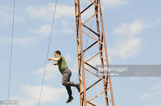 A 32yearold man called Izzet Yurtseven climbing on a hightension power pole in Izmir west Turkey receive electric shock March 17 2014 The condition...