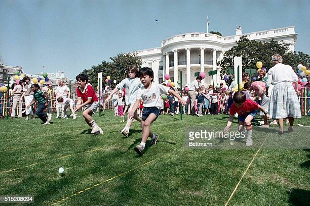 3/31/1986Washington DC Children take part in the White House Easter Egg Hunt festivities Here they are in the midst of an Easter Egg race