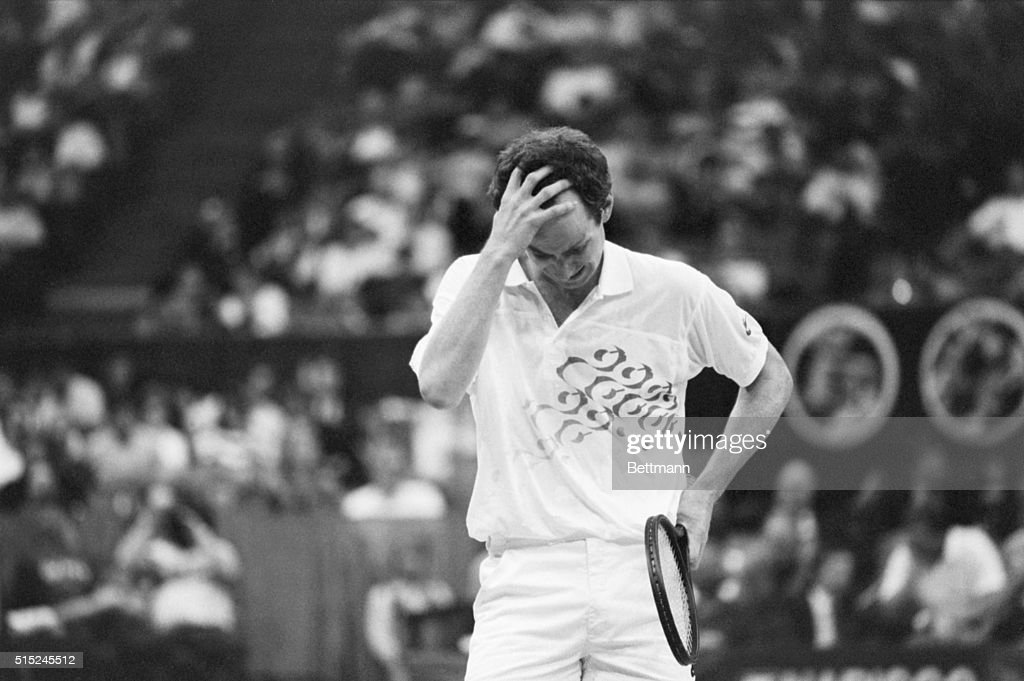 A frustrated John McEnroe clutches his head after blowing a point during first set action 3/3 in his in WCT semifinal match against Ivan Lendl in...