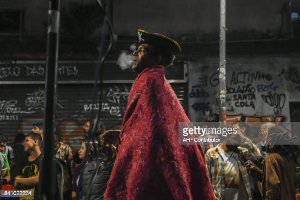 33yearold homeless Anderson dances as the Brazilian trio 'Jazz de Boteco' plays on the street in front of the 'Bar do Nanam' bar in Rio de Janeiro...