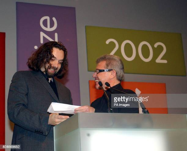 33yearold Keith Tyson receives the 2002 Turner prize from Architect Daniel Libeskind at the Tate Britain Gallery London Mr Tyson known for casting...