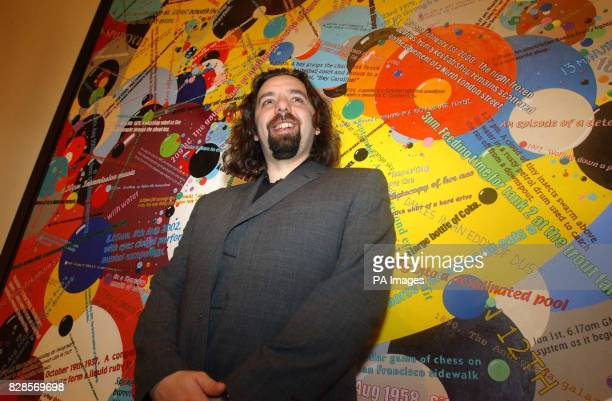 33yearold Keith Tyson with his piece 'Bubble Chambers' after winning the 2002 Turner prize at the Tate Britain Gallery London Mr Tyson *known for...