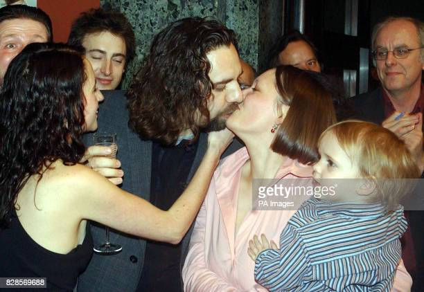 33yearold Keith Tyson with wife Zena and son Elvis celebrate after winning the 2002 Turner prize at the Tate Britain Gallery London *Mr Tyson known...