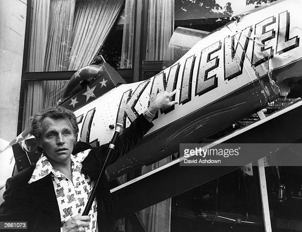 35yearold American millionaire daredevil Evel Knievel points to his name emblazoned on the side of his 'Sky Cycle' the vehicle in which he recently...