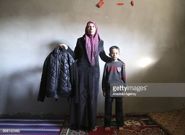 35yearsold Syrian refugee widow mother Emira Hammadi fled from Syria due to ongoing civilwar poses with her son Mehmet Hammadi as she hold his...