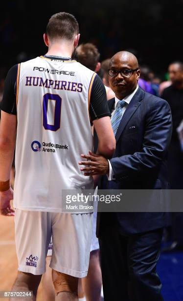 36ers coach Joey Wright shakes hands with Isaac Humphries of Sydney during the round seven NBL match between Adelaide 36ers and the Sydney Kings at...