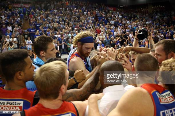 36ers players celebrate after winning game one of the NBL Semi Final series between the Adelaide 36ers and the Melbourne Tigers at Adelaide...