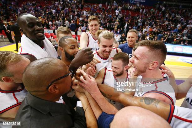 36ers players celebrate victory in the round one NBL match between the Sydney Kings and the Adelaide 36ers at Qudos Bank Arena on October 7 2017 in...