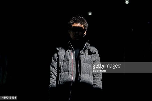 A 36yearold day trader known by the Internet handle CIS stands for a photograph in Tokyo Japan on Tuesday Feb 18 2014 While a lot of investors were...