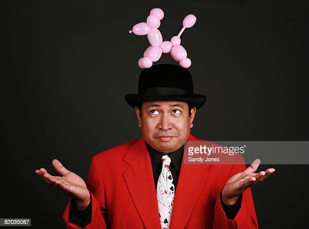 36-year-old hispanic magician with a balloon dog