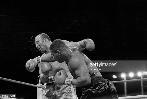 3/7/1987Las Vegas Nevada Blood streaming down his face from a cut over his left eye James 'Bonecrusher' Smith is knocked back by a right from Mike...