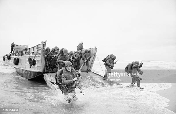 3/8/1965Da Nang South Vietnam US marines splash ashore from a landing vesel at a beach some ten miles north of Da Nang early March 8th The...