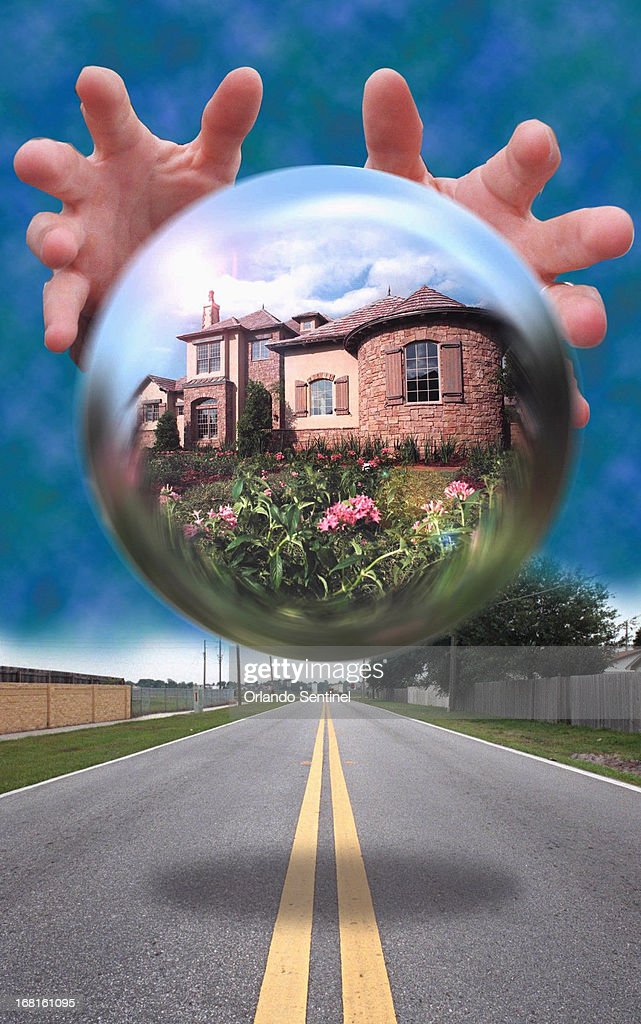 39p x 62p Tom Burton color photo illustration of hands encircling a globe that contains an image of an old house.
