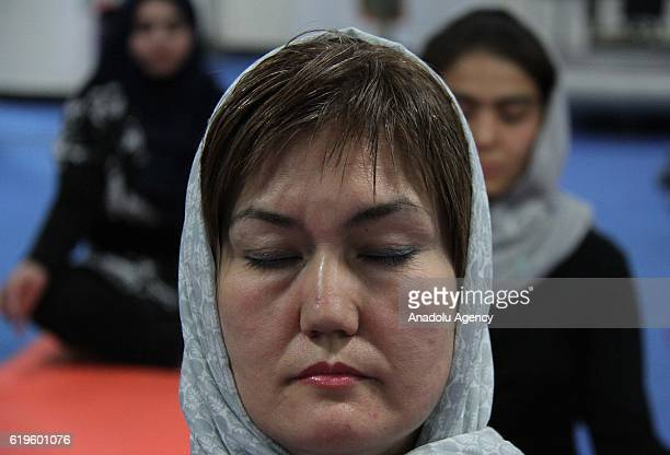 39yearold Fakhria Momtaz teaches yoga for Afghan women at a yoga club in Kabul Afghanistan on November 1 2016 The first yoga center has opened in the...