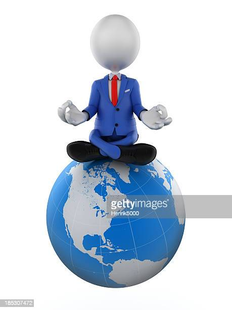 3d businessman meditating on earth globe, isolated with clipping path
