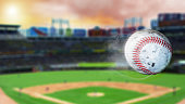 3d illustration of flying baseball leaving a trail of smoke. Spinning dirty baseball, selerctive focus.Leadership concept, One glowing light bulb standing in front of unlit incandescent bulbs with ref