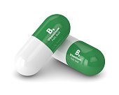 3d render of B9 folic acid pills isolated over white background. Concept of dietary supplements
