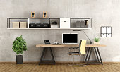 Contemporary home office with  laptop on minimalist desk - 3d rendering-