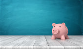 3d rendering of a pink piggy bank in front view standing on a wooden table. Domestic budget. Saving money. Family finances.