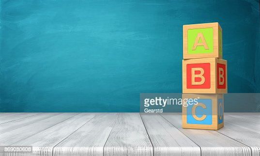 3d rendering of a three toy blocks standing on a wooden desk in one tower with letters A, B and C on them. : Stock Photo