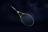 3d rendering of a yellow and black professional tennis racquet hanging in spotlight on a white background. Sport equipment. Single player game. Athletic competition.