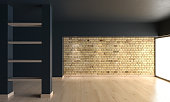 Empty room with a brick wall and shelves between columns