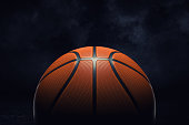 3d rendering of an orange rubber surface of a basketball ball shown on a black background. Basketball league. Team play. One ball in court.