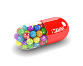 3d rendering of vitamin pill with granules over white background