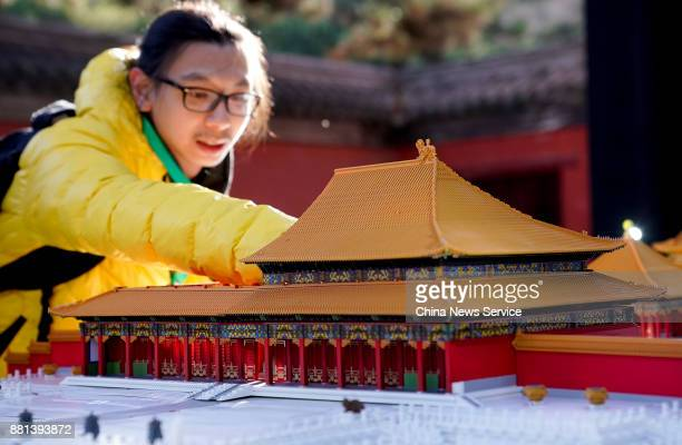 A 3Dprinted model of a Forbidden City building is assembled by a Palace Museum staff on November 28 2017 in Beijing China The model was shown at a...