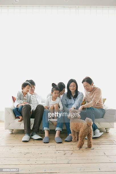 3-generation family who sit on a sofa