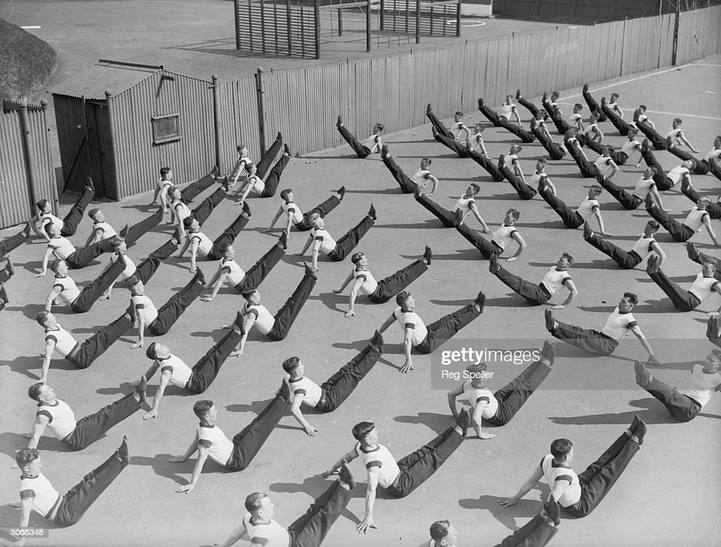 Soldiers doing floor exercises at the Army School of Physical Training Aldershot Hampshire