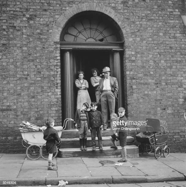 A Liverpudlian family outside their home in NorthWest England Original Publication Picture Post 7105 The Best And The Worst Of British Cities...