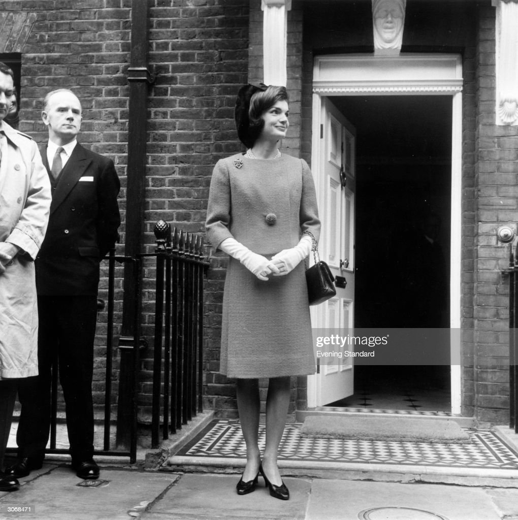 Jackie Kennedy (1929 - 1994), leaving for lunch with Queen Elizabeth II of Great Britain.