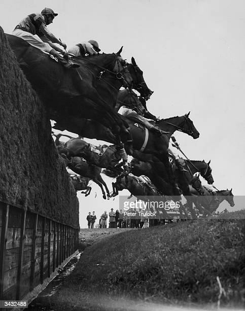 The field taking Becher's Brook first time round during the Grand National The race was eventually won by 'Specify' owned by holiday camp magnate...