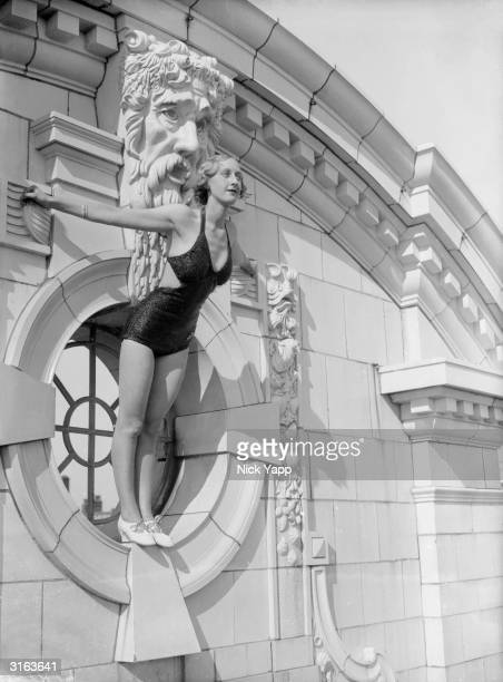 A live figurehead posing in front of stonework at Blackpool holiday resort in Lancashire