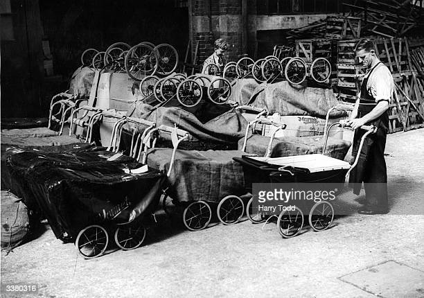 Workers at a Marmet pram factory in Letchworth Hertfordshire do their best to solve the shortage of baby carriages in Britain during World War II