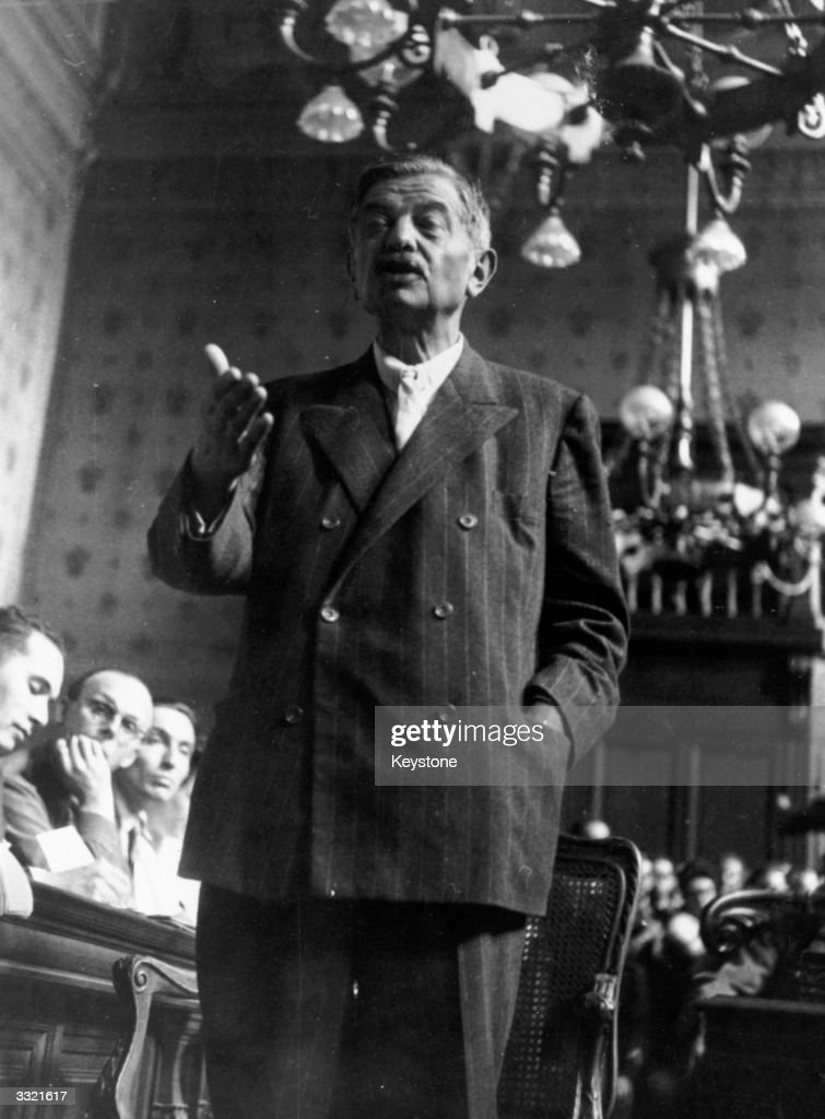 French politician Pierre Laval (1883 - 1945), Marshal Petain's deputy in the Vichy government, during cross-examination by the prosecution at Petain's trial. Laval was condemned to death as a collaborationist and executed.