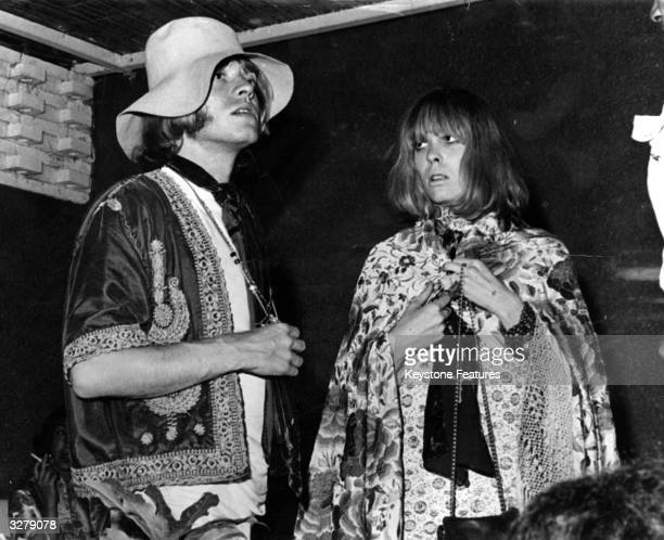 Brian Jones of the pop group the Rolling Stones relaxes on holiday with girlfriend Suki Poitier at Philip Meek's house in Marbella