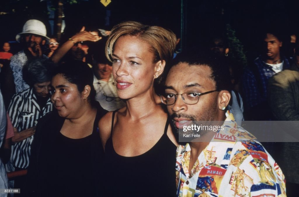 American director Spike Lee, wearing a Hawaiian print shirt, and his wife, Tanya, walking past a crowd at the New York premiere of the HBO television film, 'Introducing Dorothy Dandridge' at the Chelsea West Cinema, New York City.