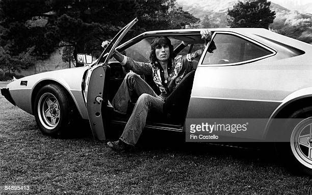 English rock drummer Cozy Powell posed in his Ferrari car at the Observatory in Los Angeles USA on 3rd August 1977
