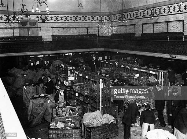 Royal Mail employees working to deal with the Christmas post in a makeshift sorting room at St Pancras Baths