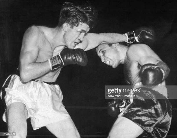 American boxer Jake La Motta weaves under under a punch thrown by Tommy Yarosz in the third round of their bout at Madison Square Garden New York City