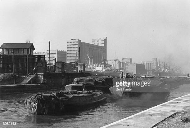 Heavy traffic along the River Thames near the West India Dock in East London Original Publication Picture Post 4931 The Pool Of London pub 1949