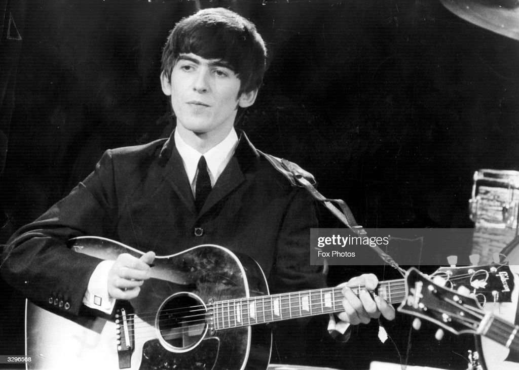 Guitarist and singer <a gi-track='captionPersonalityLinkClicked' href=/galleries/search?phrase=George+Harrison&family=editorial&specificpeople=90945 ng-click='$event.stopPropagation()'>George Harrison</a> (1943 - 2001) of the popular Merseybeat group The Beatles, performing during a live concert.
