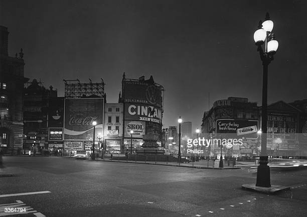 Unlit advertisements and hardly any traffic at Piccadilly Circus during the fuel crisis